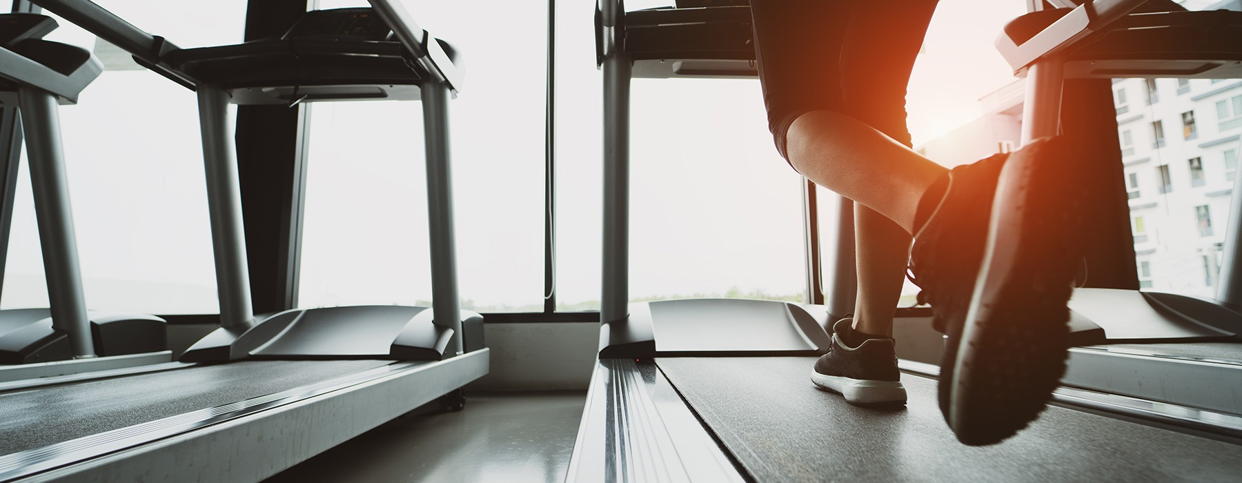 lifestyle image of a person's foot as they run on the treadmill