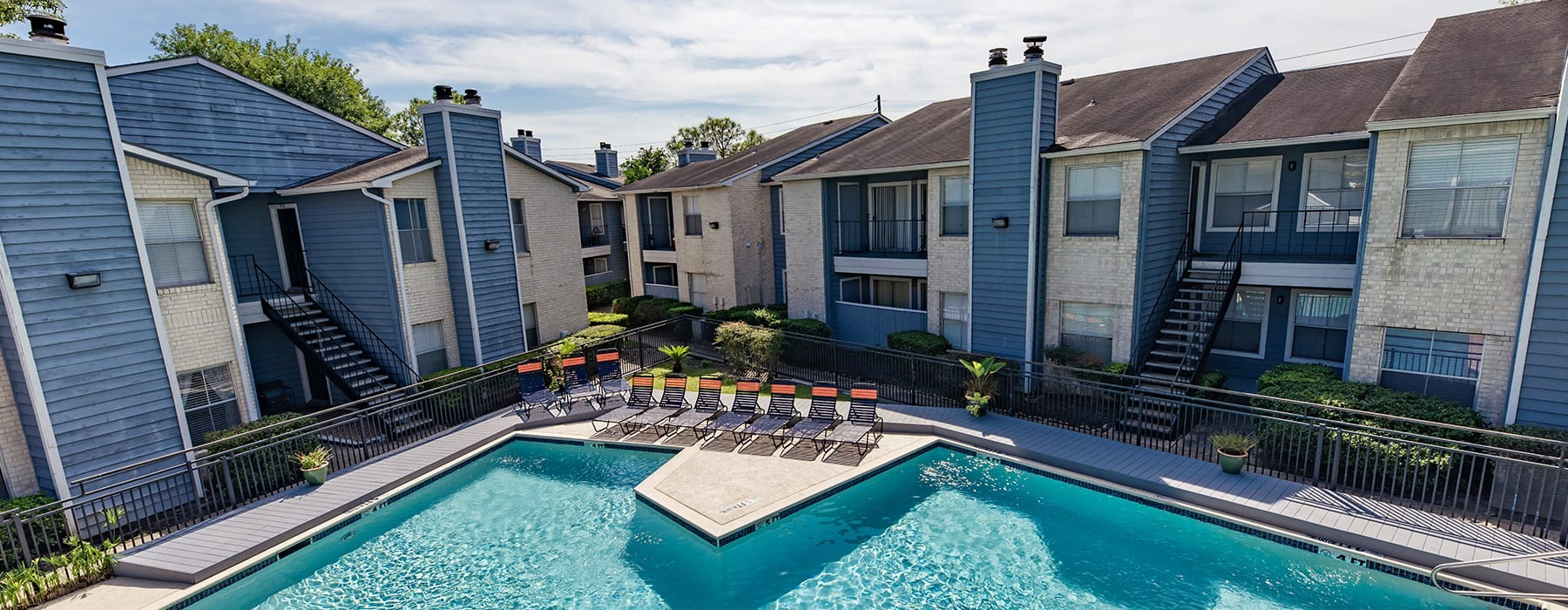 spacious pool with ample seating and nearby landscaping